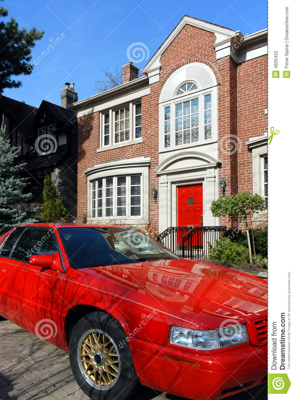 red car parked in front of house stock photography image