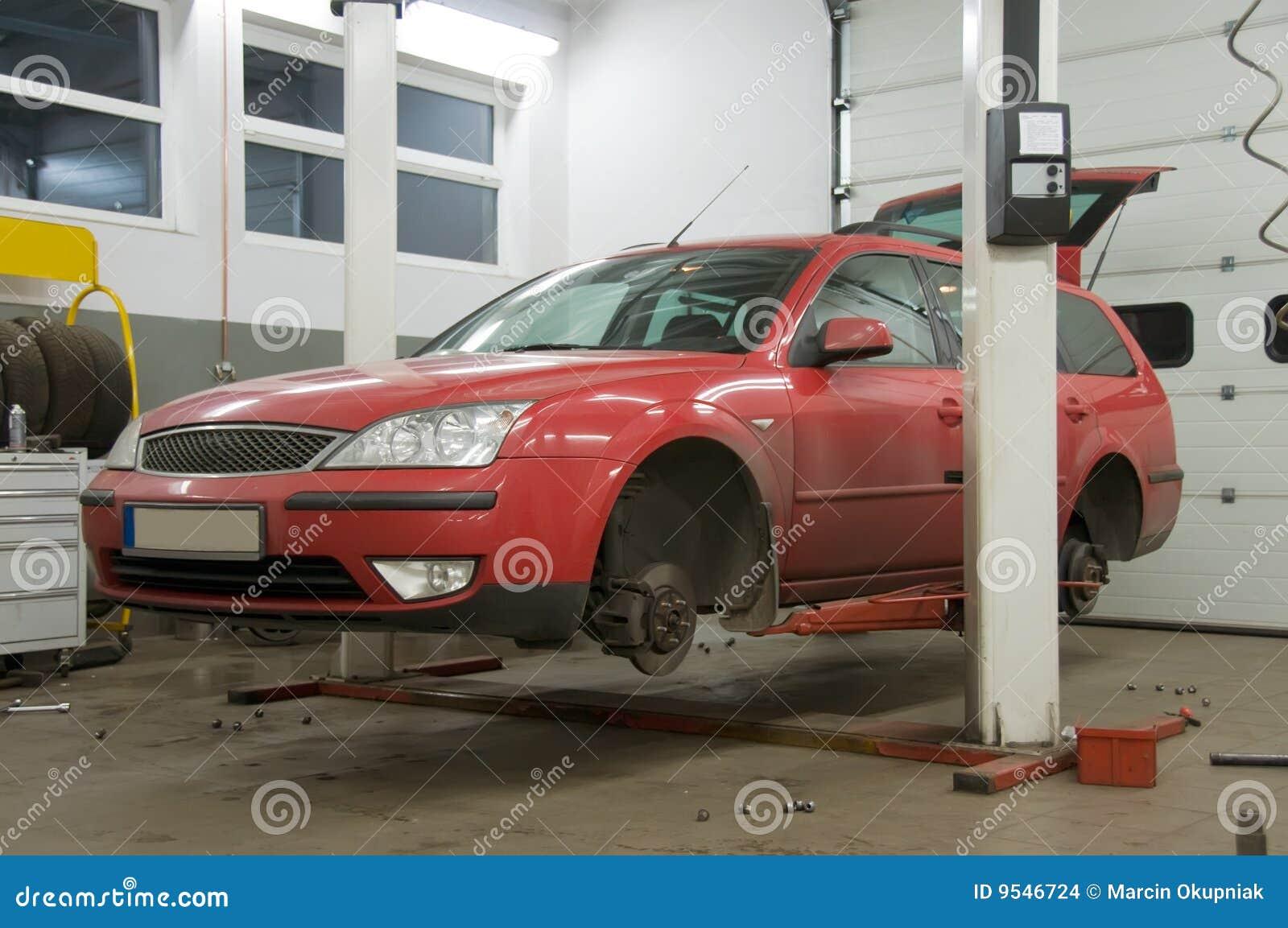 Red car on raiser