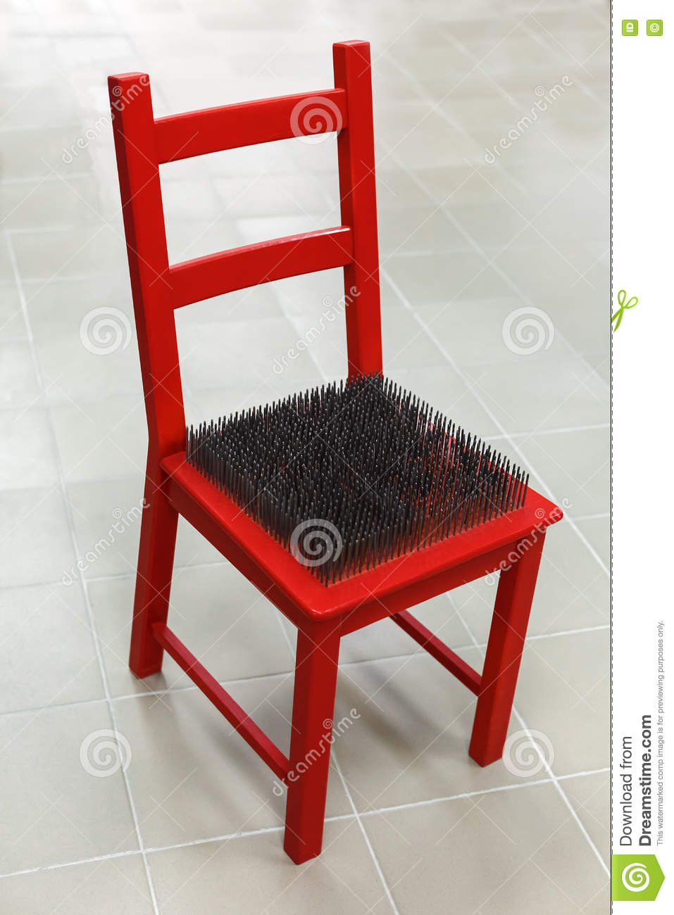 Red Chair With Spikes On The Seat Stock Image