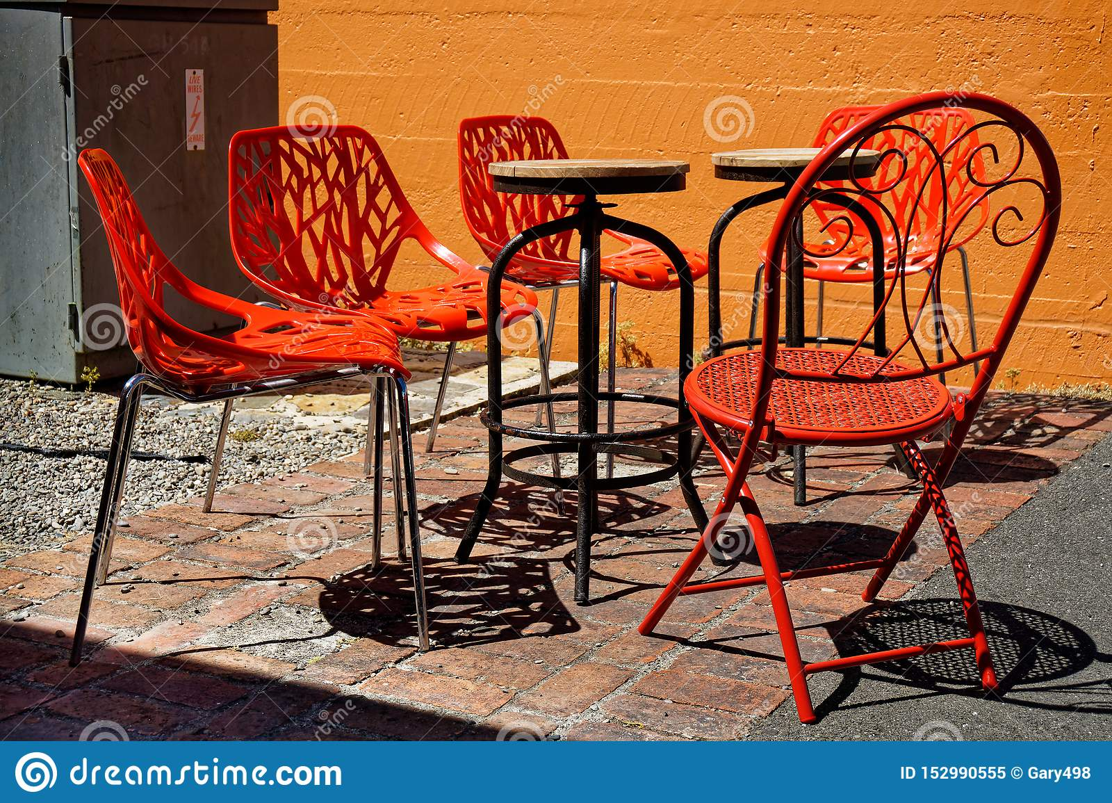Red Chairs Stackable And Collapsible In A Cafe Garden New