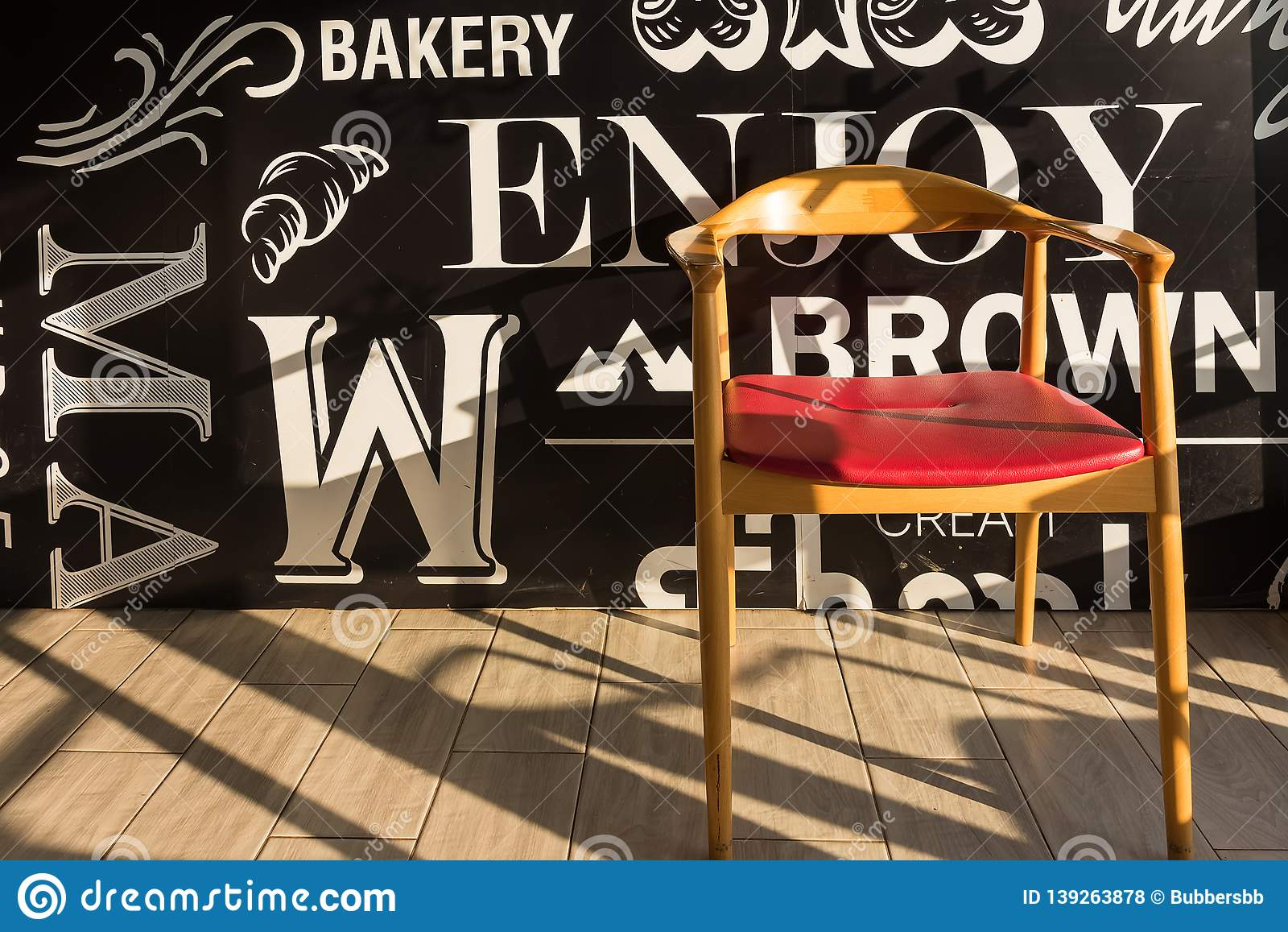 Red chairs on a wooden floor black, elegant piece of interior of restaurant