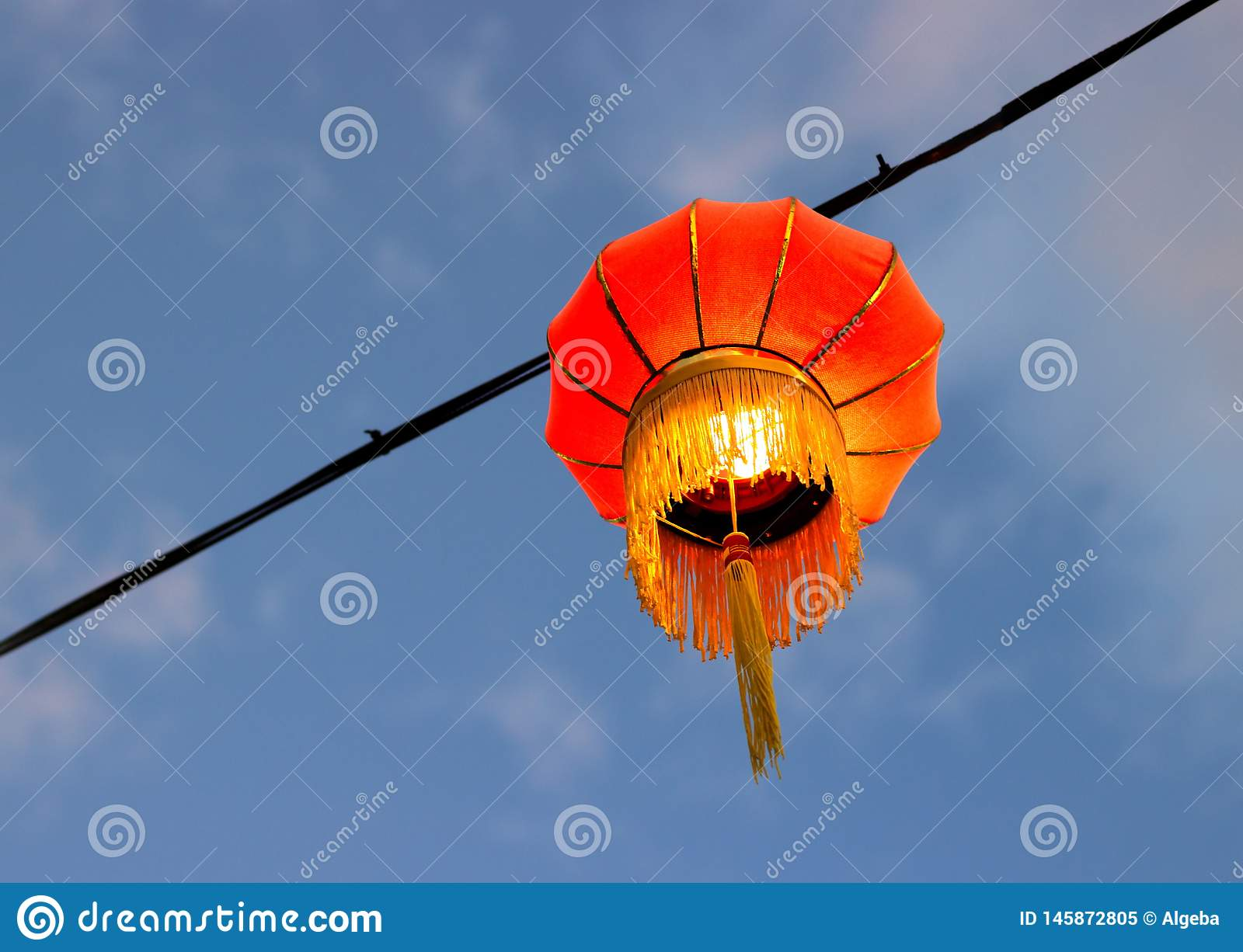 Red chinese paper lantern. Against the twilight sky background. Decorating the streets to celebrate the Chinese New Year royalty free stock photo