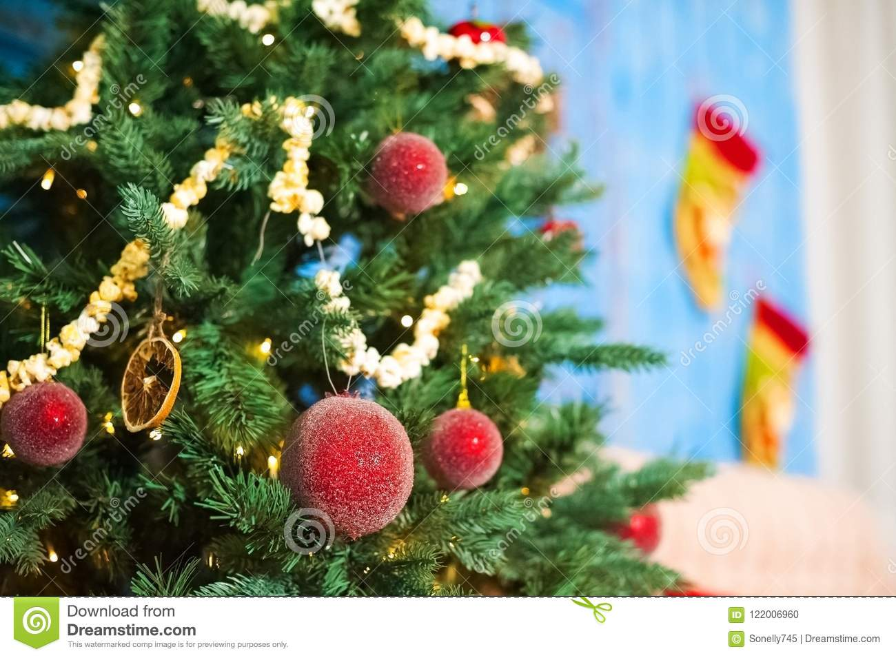 Red Christmas Balls On A Christmas Tree On A Background Of Blue Old