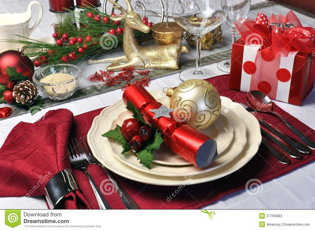 Red christmas day table setting with present stock image for Christmas place setting gift ideas