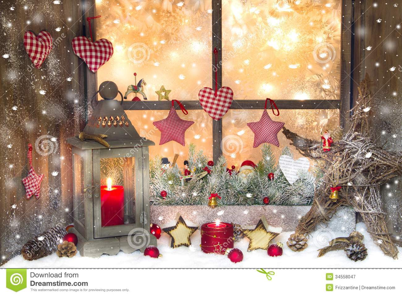 Red christmas decoration with lantern on window sill with for Decoration de fenetre exterieur