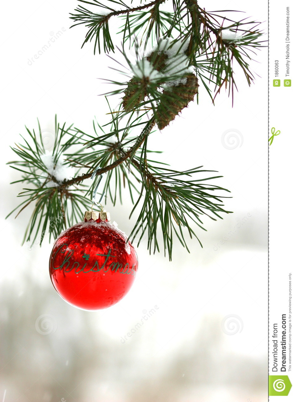 Red Christmas Decoration On Snow Covered Pine Tree