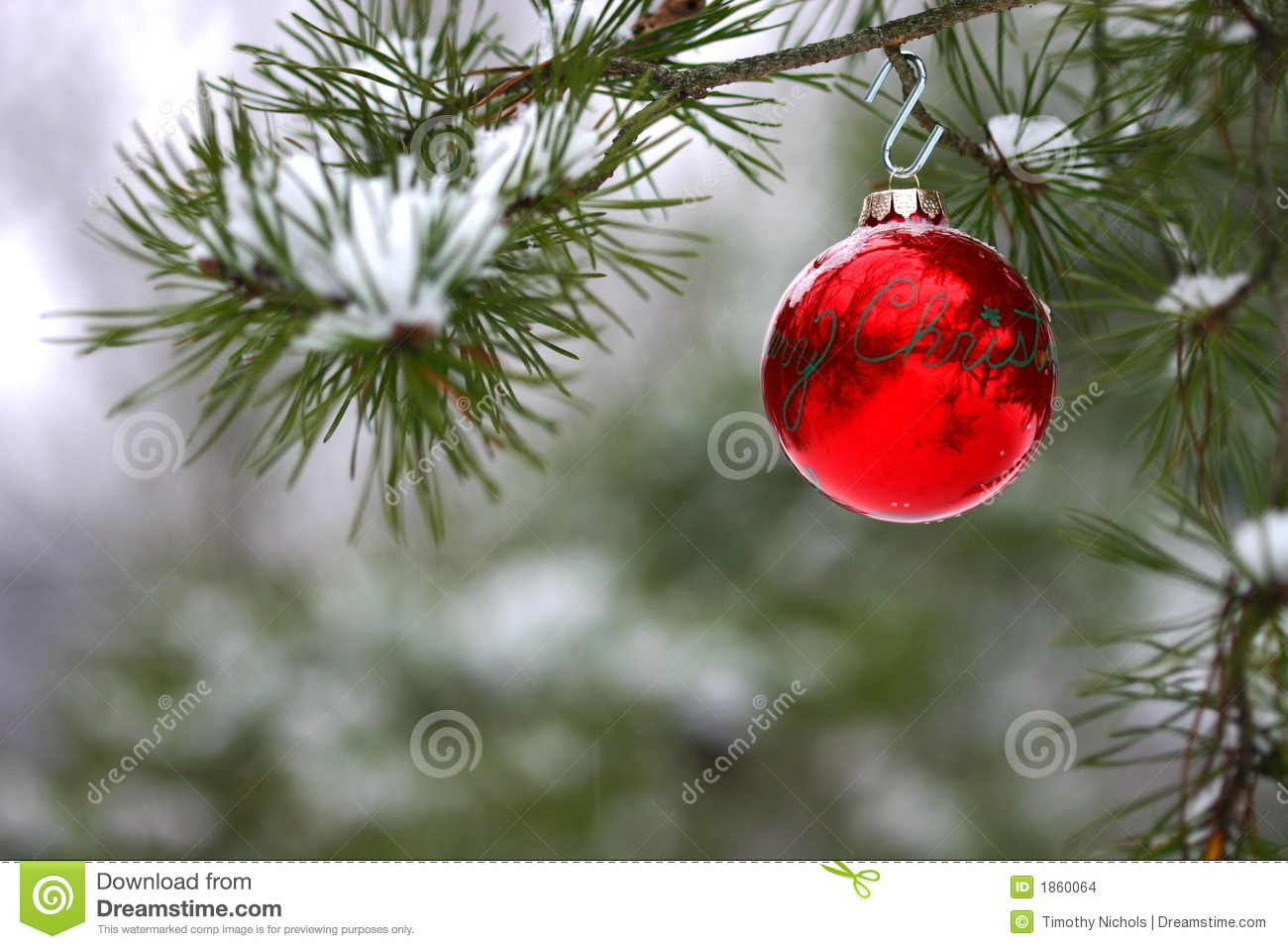 red christmas decoration on snowcovered pine tree