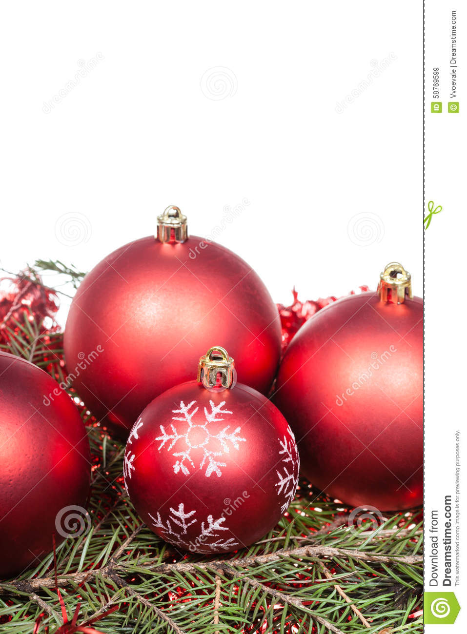 Red christmas decorations on green tree branch stock photo