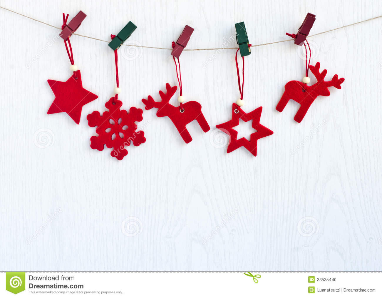 red christmas decorations hanging from a rope