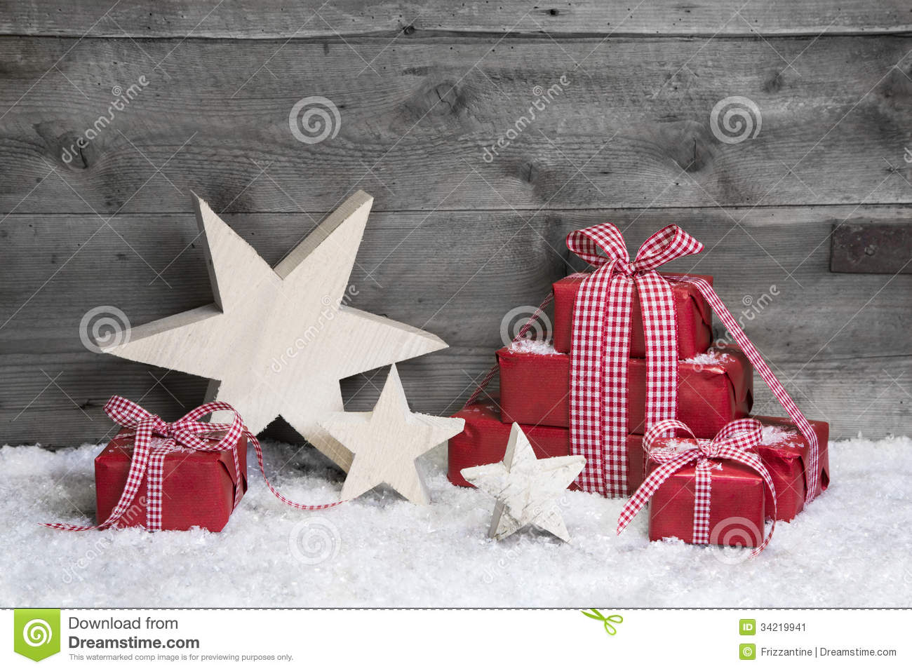 Red christmas gifts with wooden starts on grey