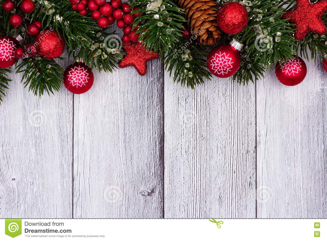 Download Red Christmas Ornaments And Branches Top Border On White Wood Stock Photo