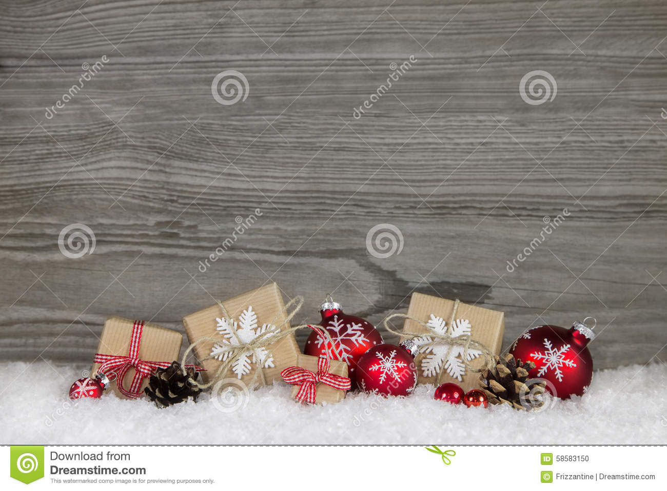 Red Christmas presents wrapped in natural paper on old wooden gr