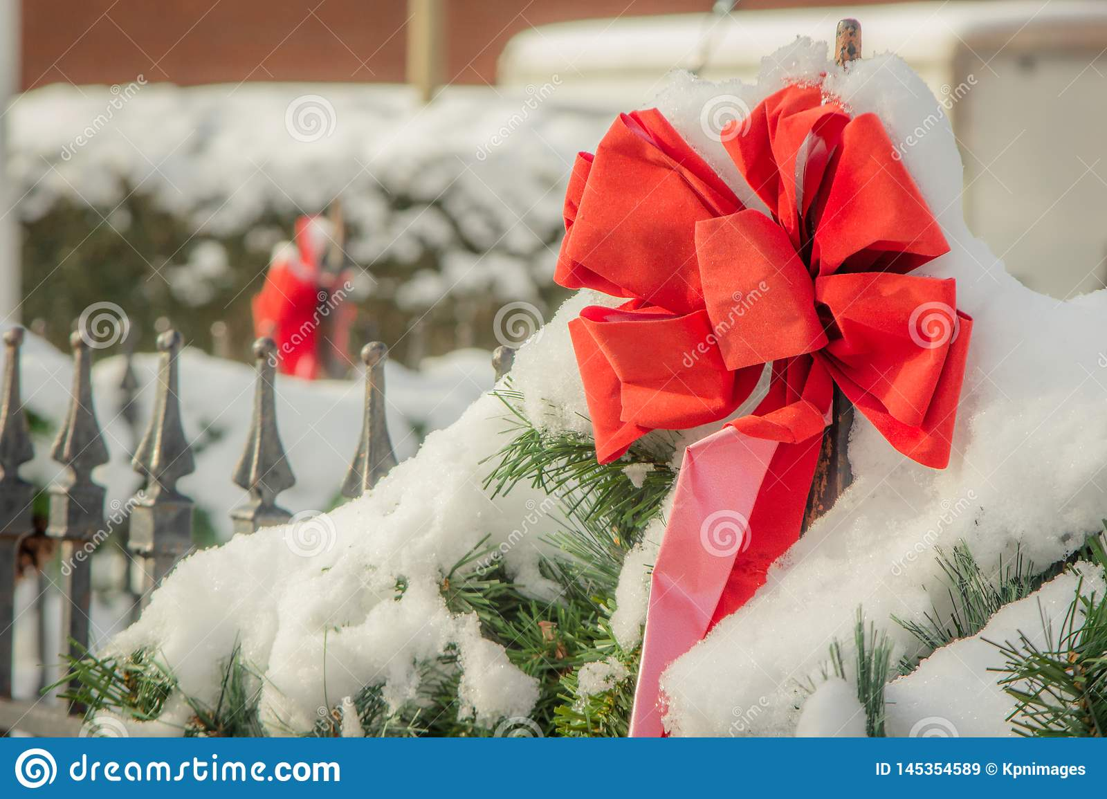 Red Christmas ribbon in the snow