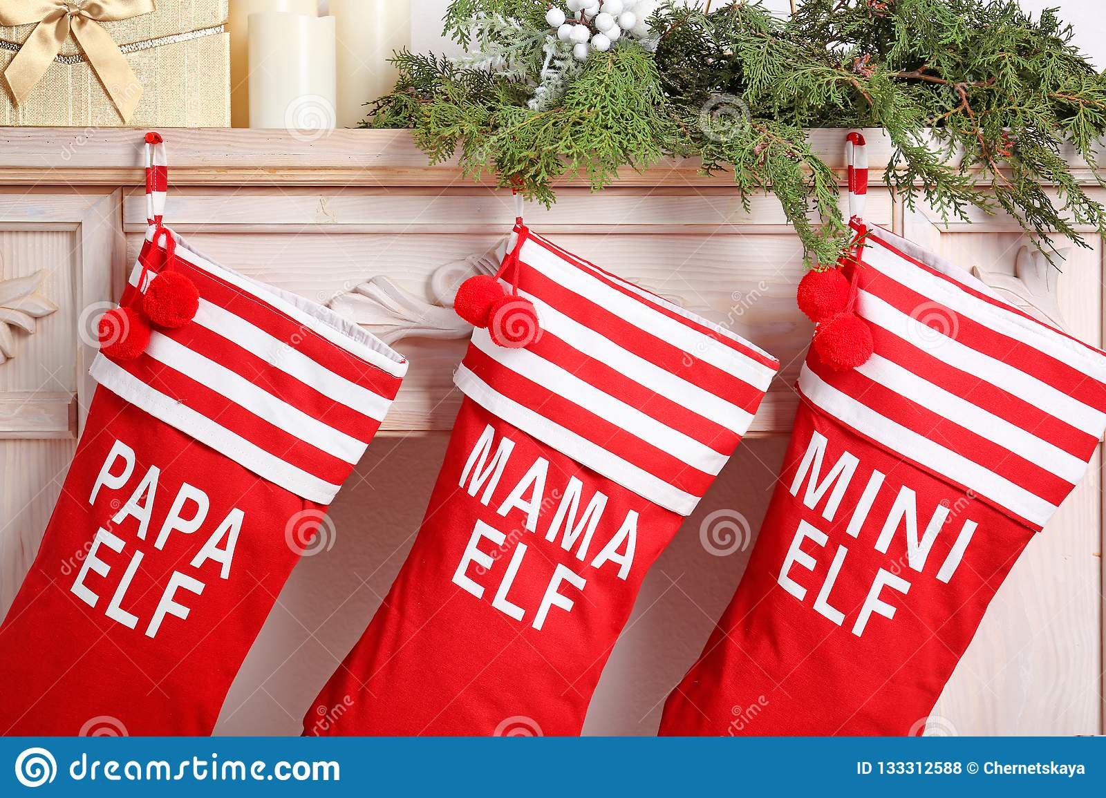 e97718bd6f3 Red Christmas Stockings Hanging On Decorated Fireplace Stock Photo ...