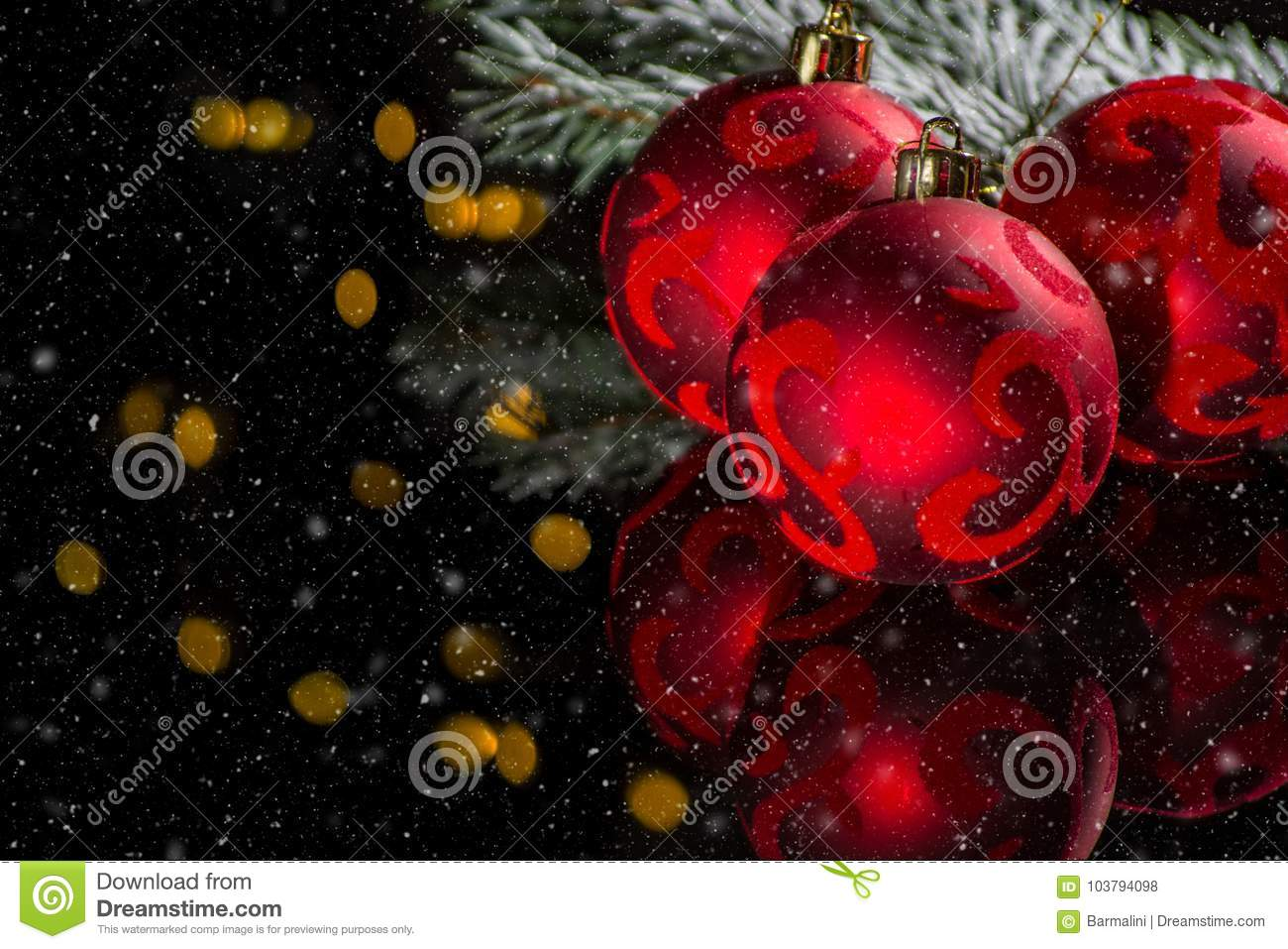 Red christmas tree decoration, red balls and green fir on black