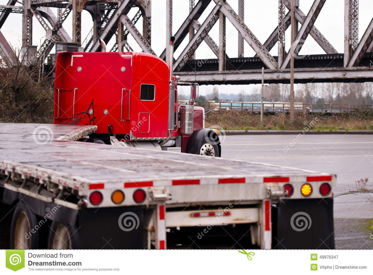 Red Classic Big Rig Truck Old Bridge Flat Beds Turning On Road ...