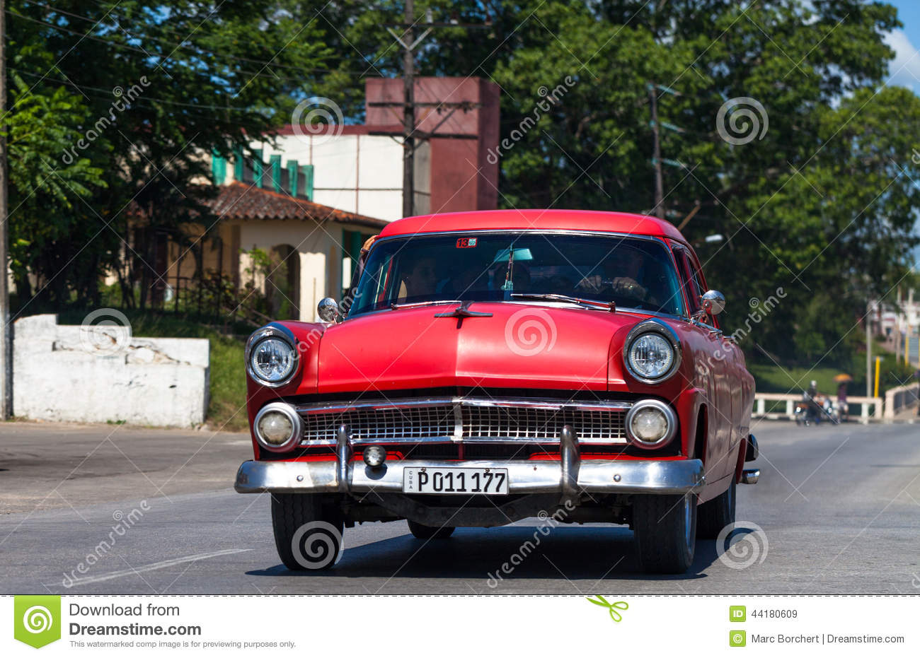A Red Classic Car Drived On The Street In Havana City