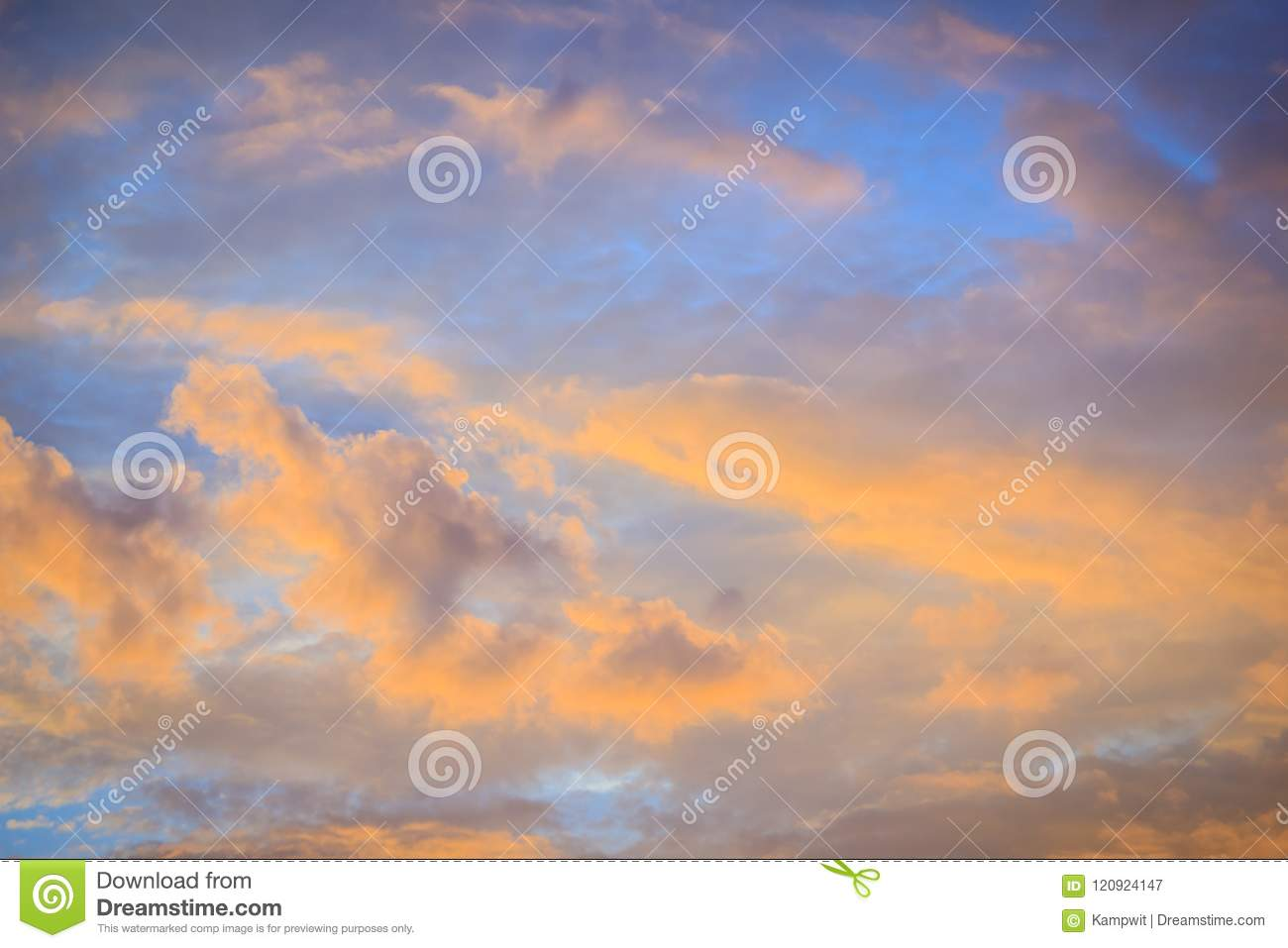 Red cloud and blue sky background. Dramatic sunset sky began to change from blue to orange.