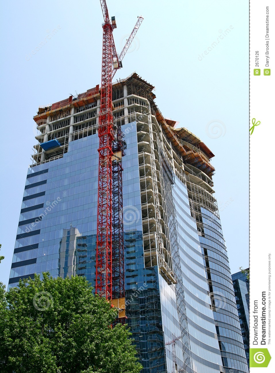 Download Red Crane and Curved Glass stock photo. Image of highrise - 2670126
