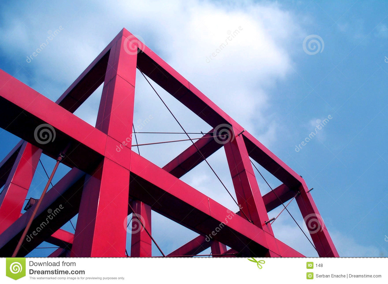Red cube against blue sky