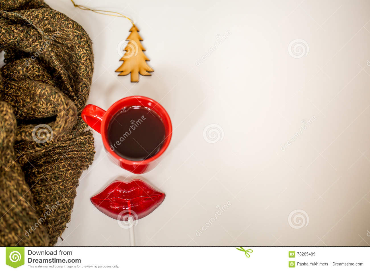 red cup of hot drink with christmas items