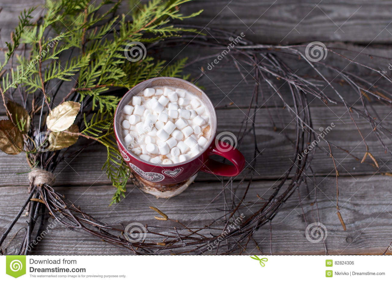Red Cup With Marshmallow Is Framed By A Christmas Wreath Stock Photo