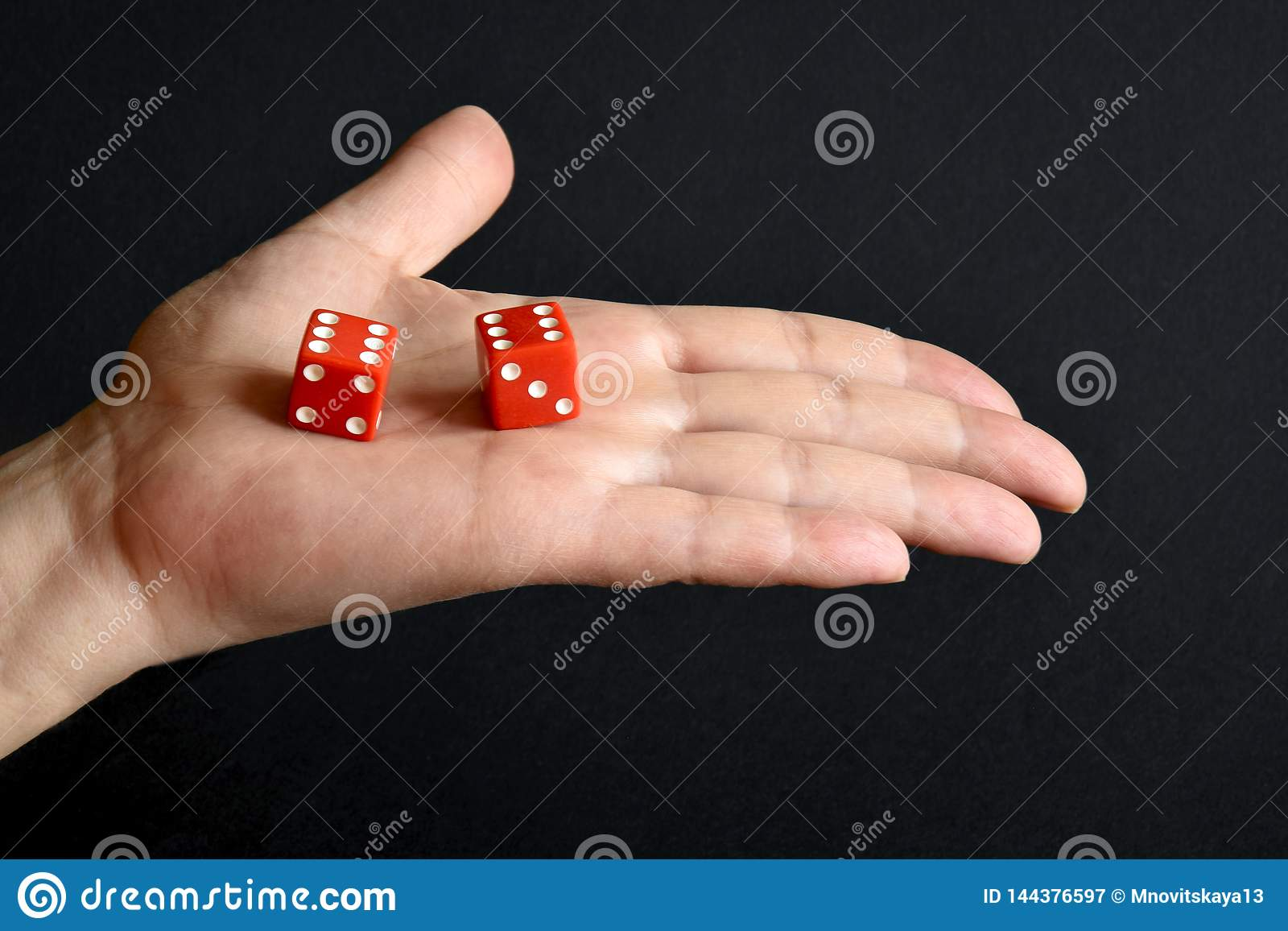 Red dices on the male palm
