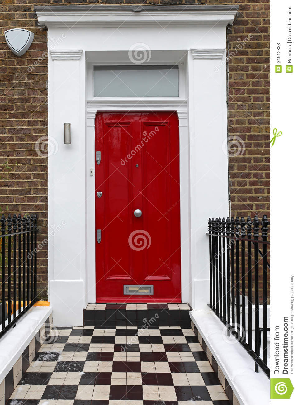 Red entrance door in front of residential house stock photo - Red Door Royalty Free Stock Photos Image 34912838
