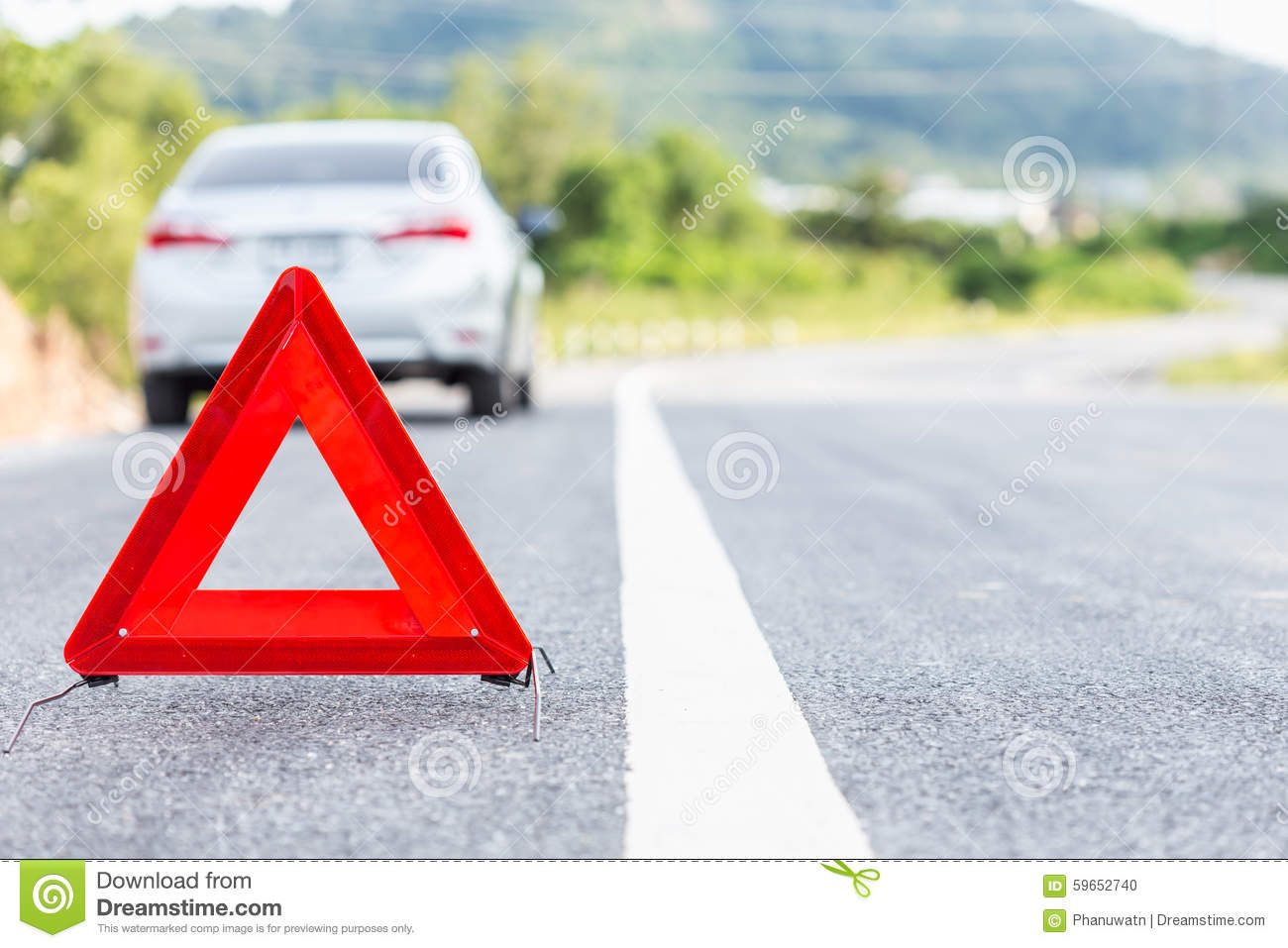Red emergency stop sign and broken silver car