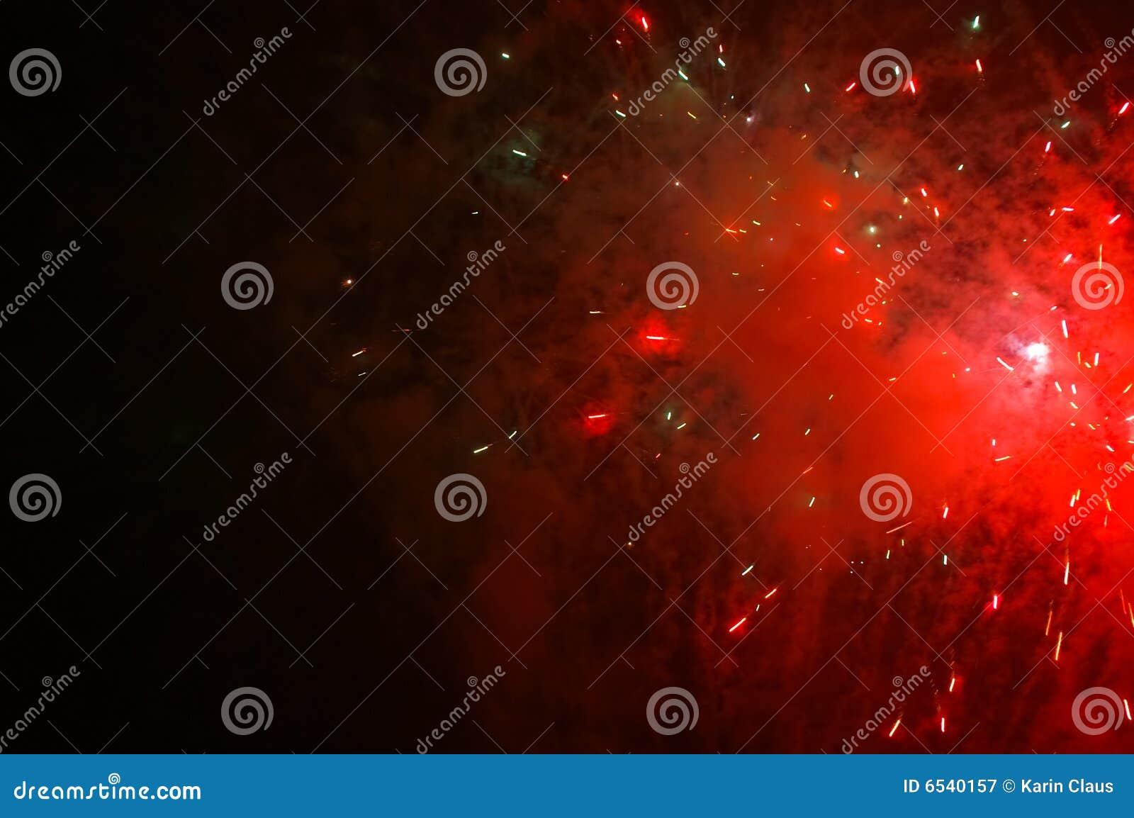 Red exploding fireworks on a dark sky