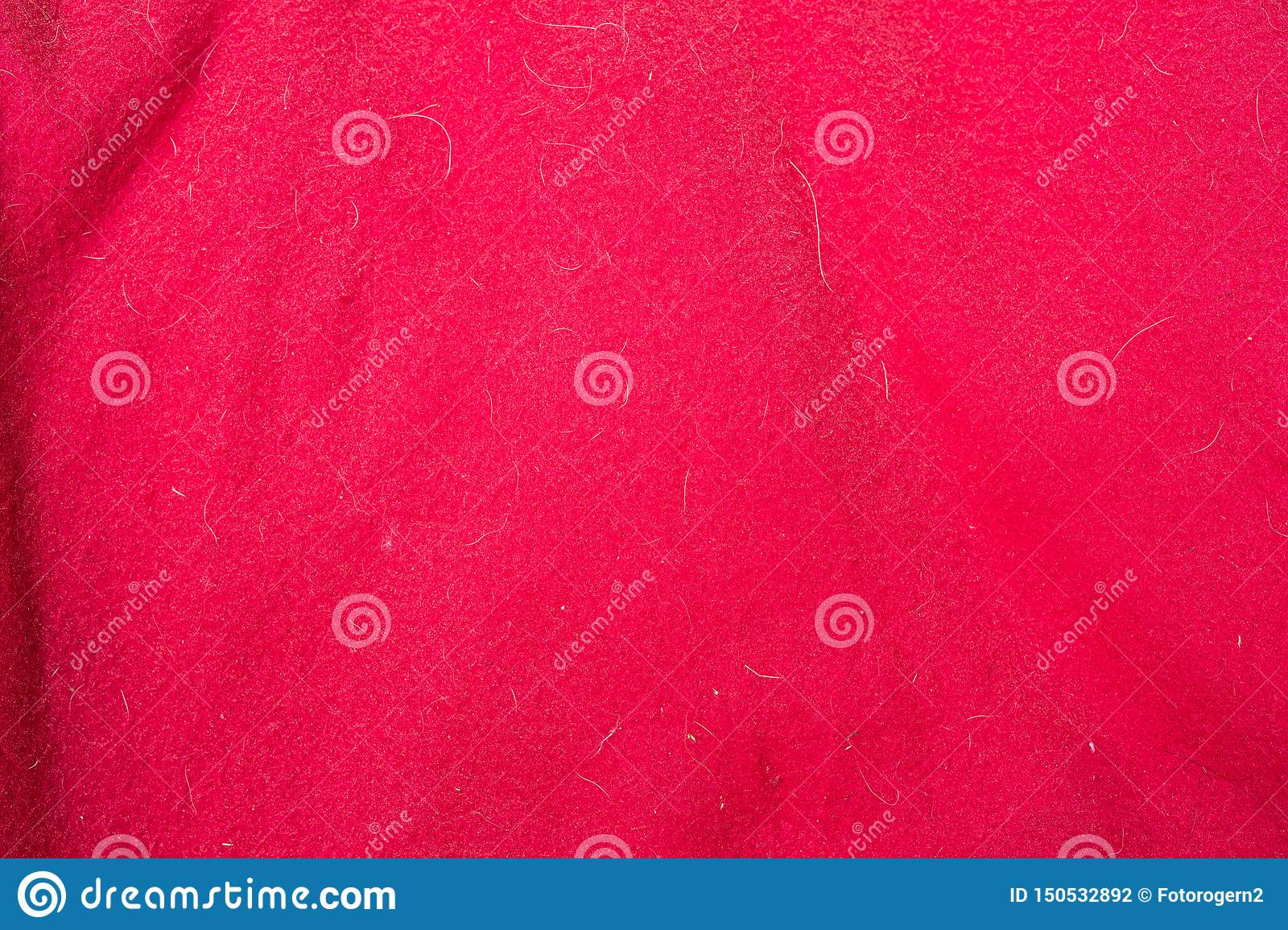 Red fabric texture with doghair and spots