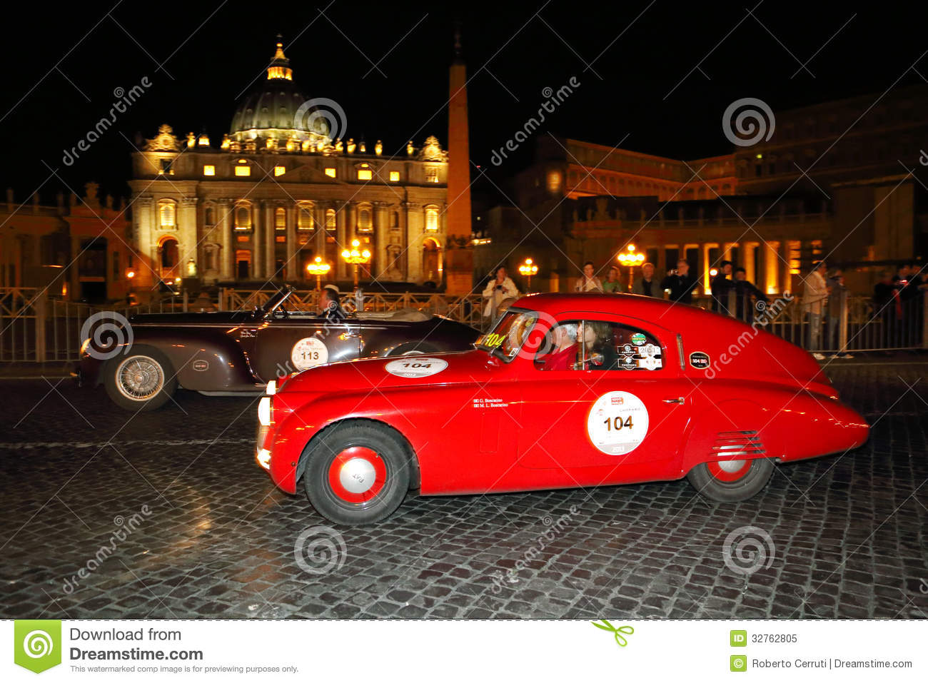 Red Fiat 508, 1938, and brown Alfa Romeo 6C 2500, 1940, drives by Piazza San Pietro the 1000 Miglia