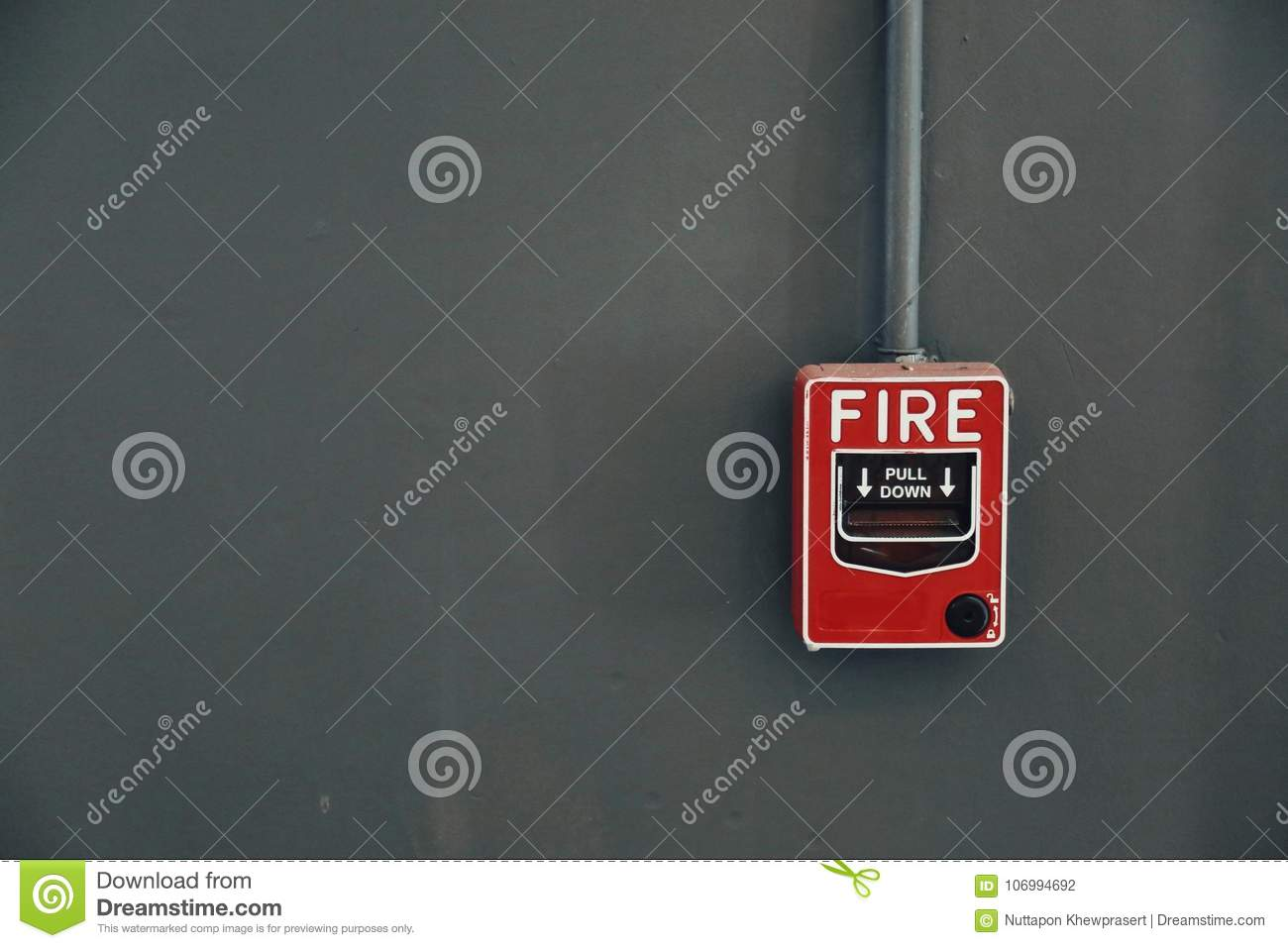 A Red Fire Alarm Pull Station On The Grey Wall Stock Photo Image