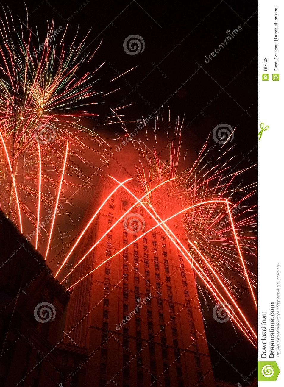 Red fireworks around a tall building