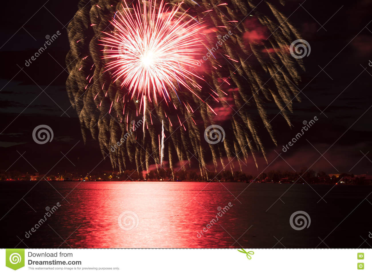 Red Fireworks Free Stock Photo: Red Fireworks Reflecting Over Lake Stock Image