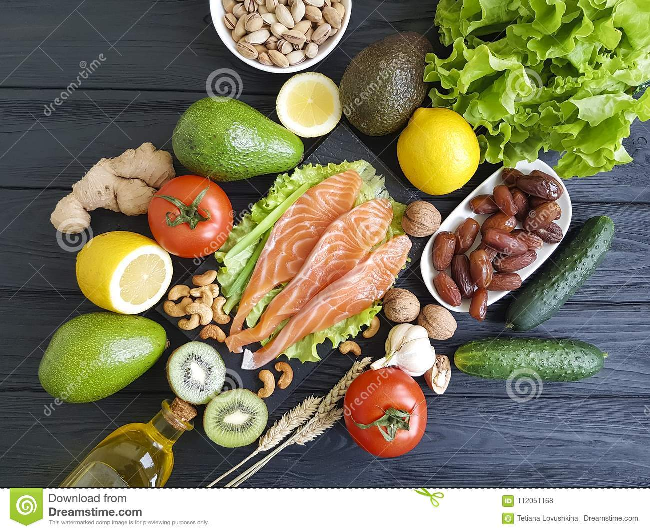 salmon fish, avocado organic green dietary on a wooden healthy food assorted