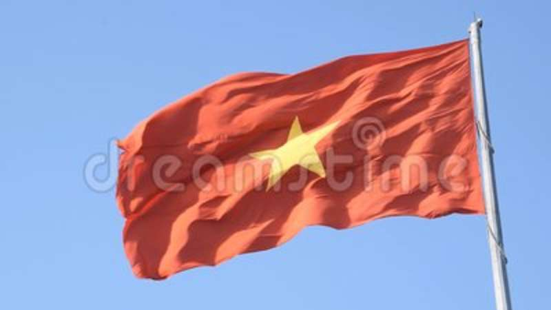 red flag with yellow star. flag of vietnam on the blue sky