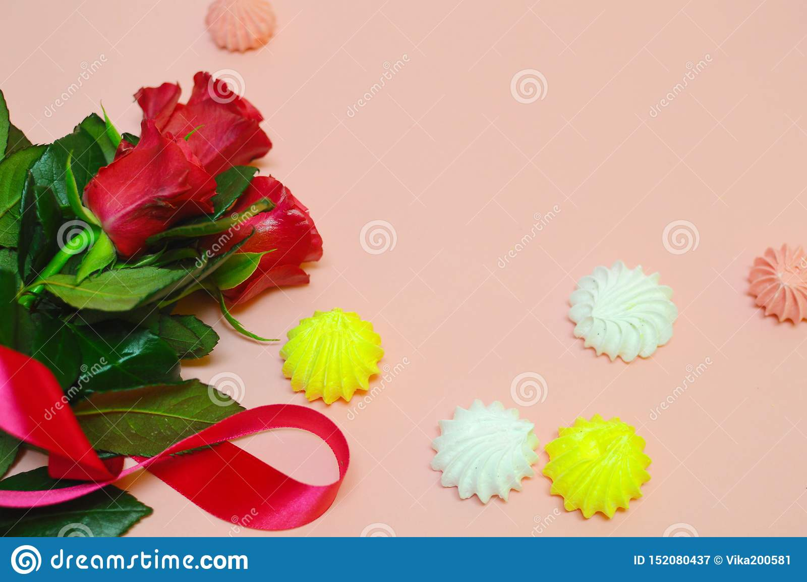 Red flowers on a pink background with copy space.