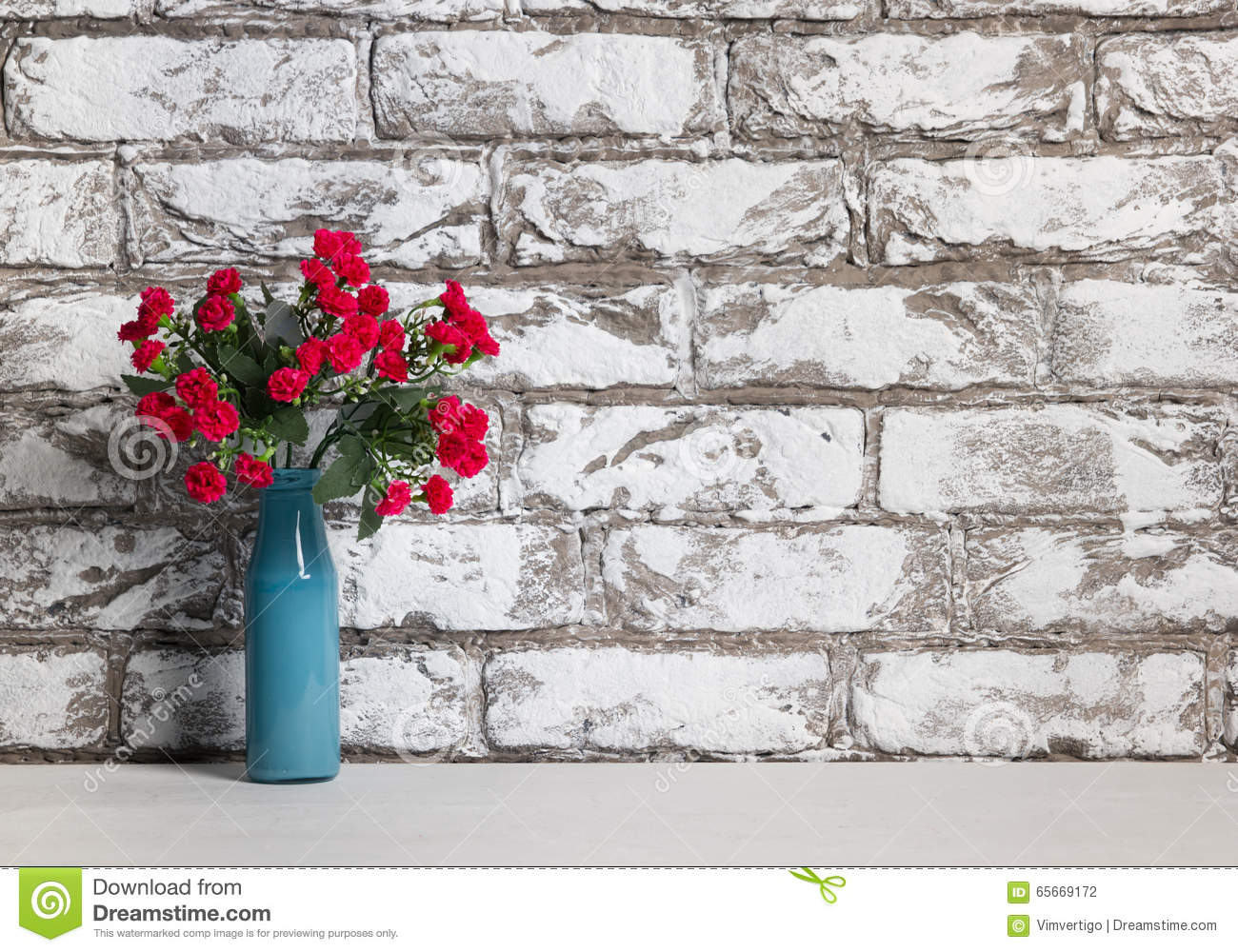 Red flowers in vase on the table on black and white brick wall red flowers in vase on the table on black and white brick wall background reviewsmspy