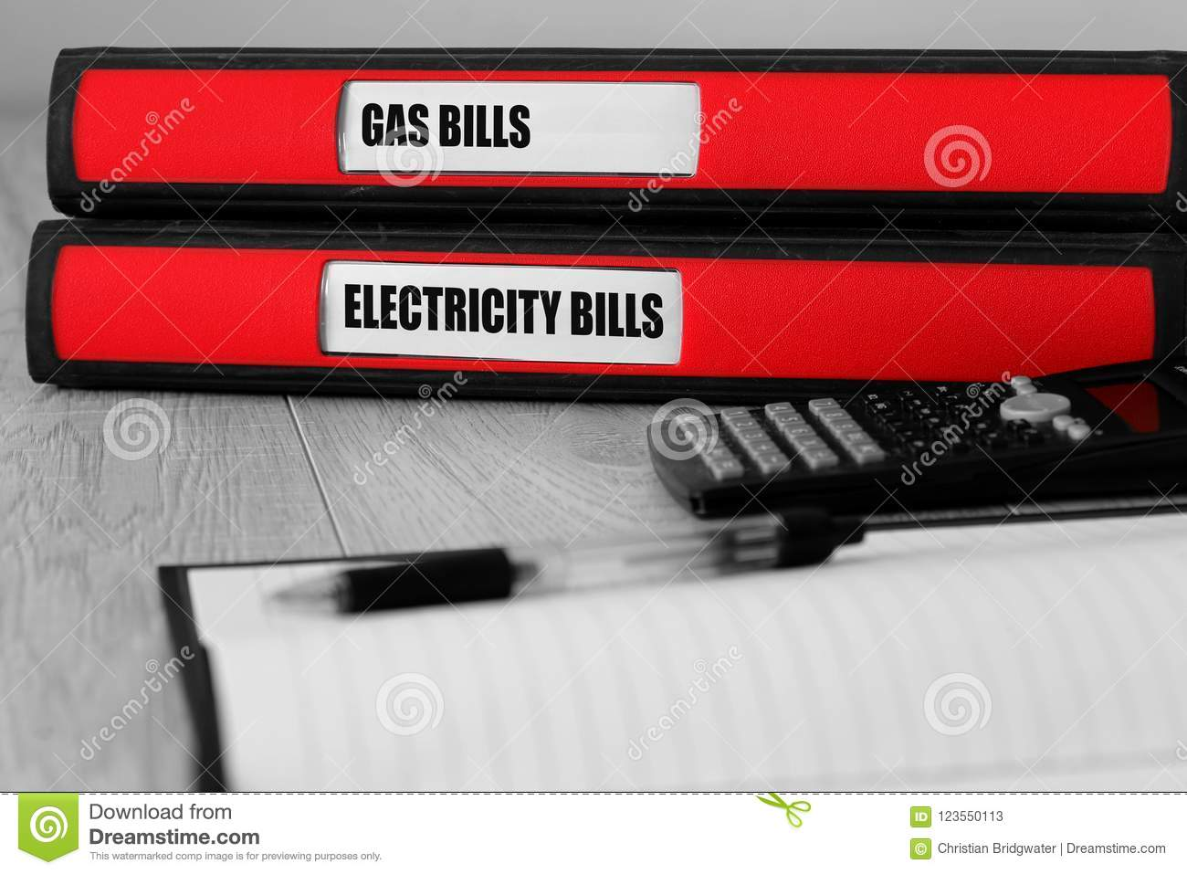 Red Folders With Gas And Electricity Bills Written On The Label On A ...