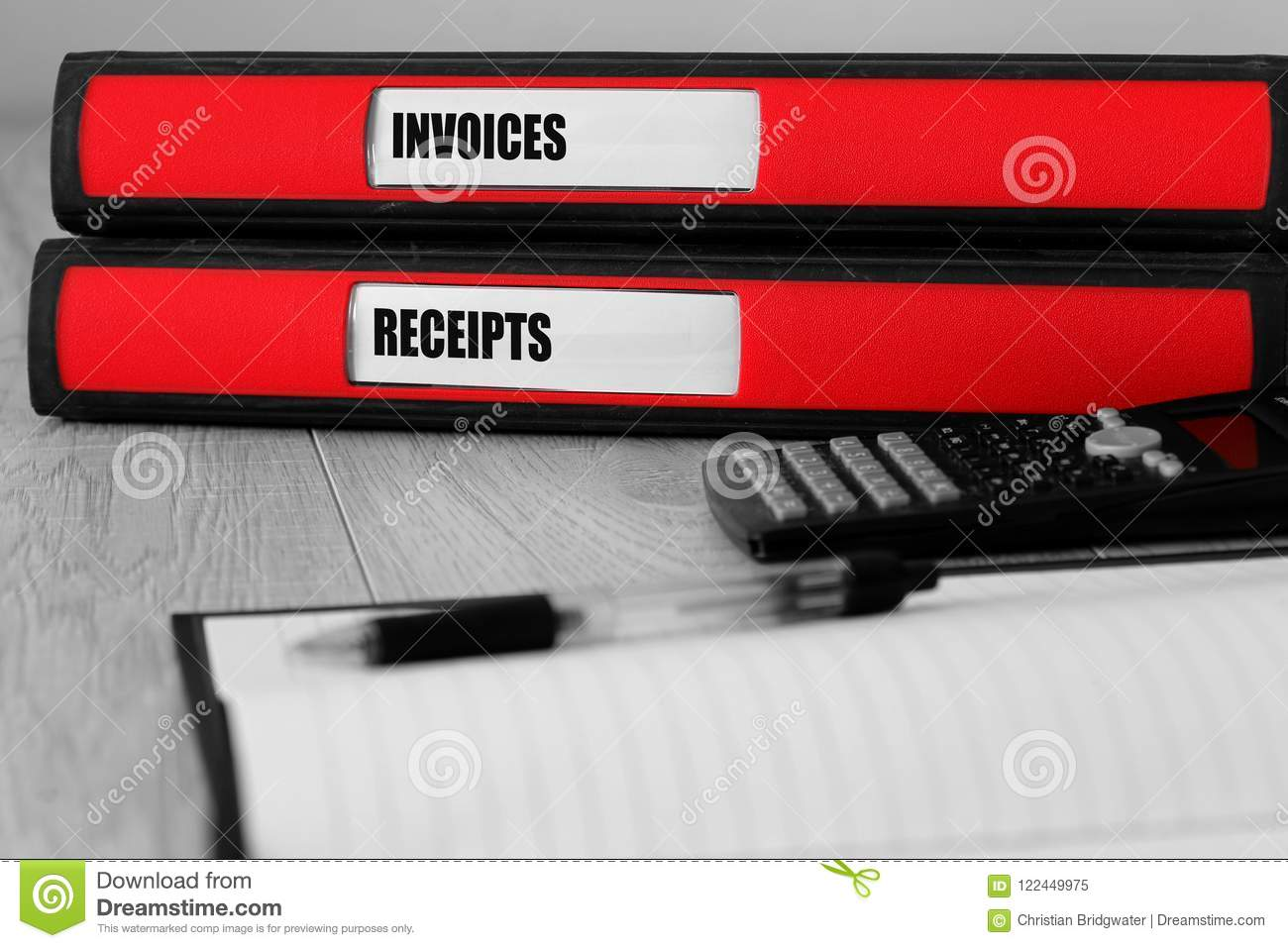 red folders with invoices and receipts written on the label on a