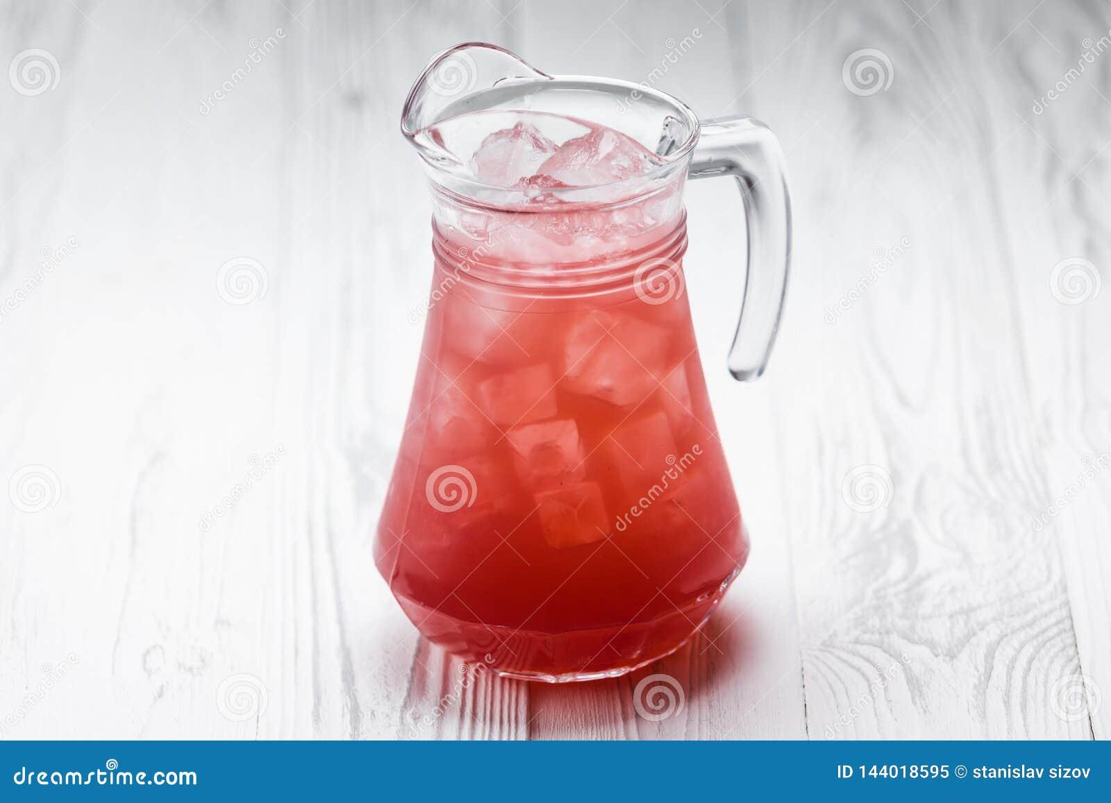 Red fresh homemade lemonade drink in a jar