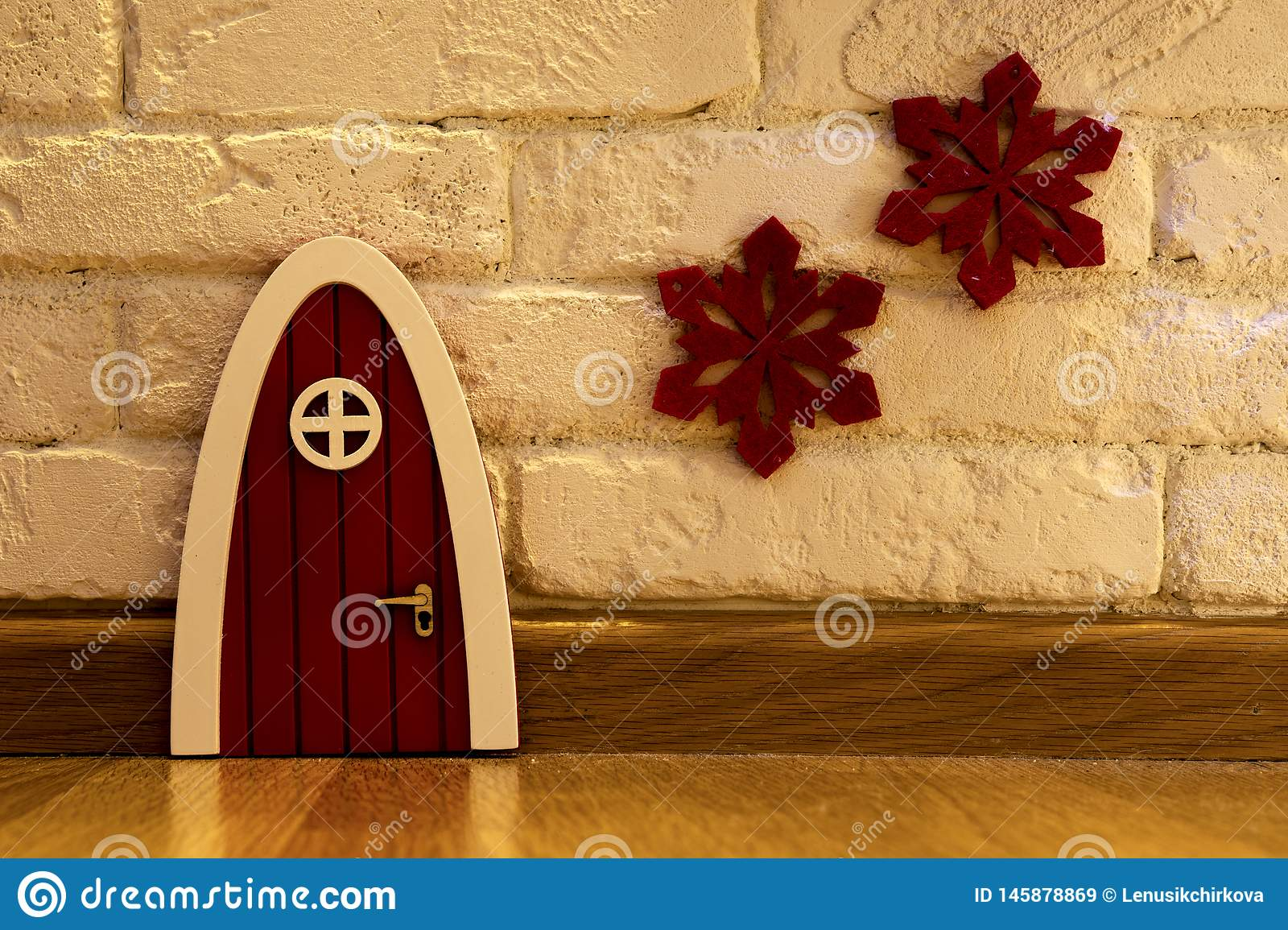 Red front door of a gnome house
