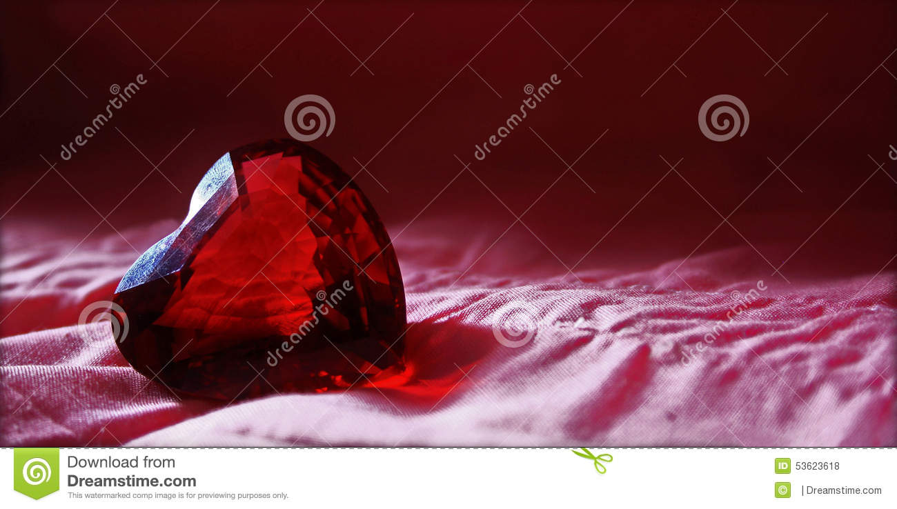 Red glas heart diamond with pink background