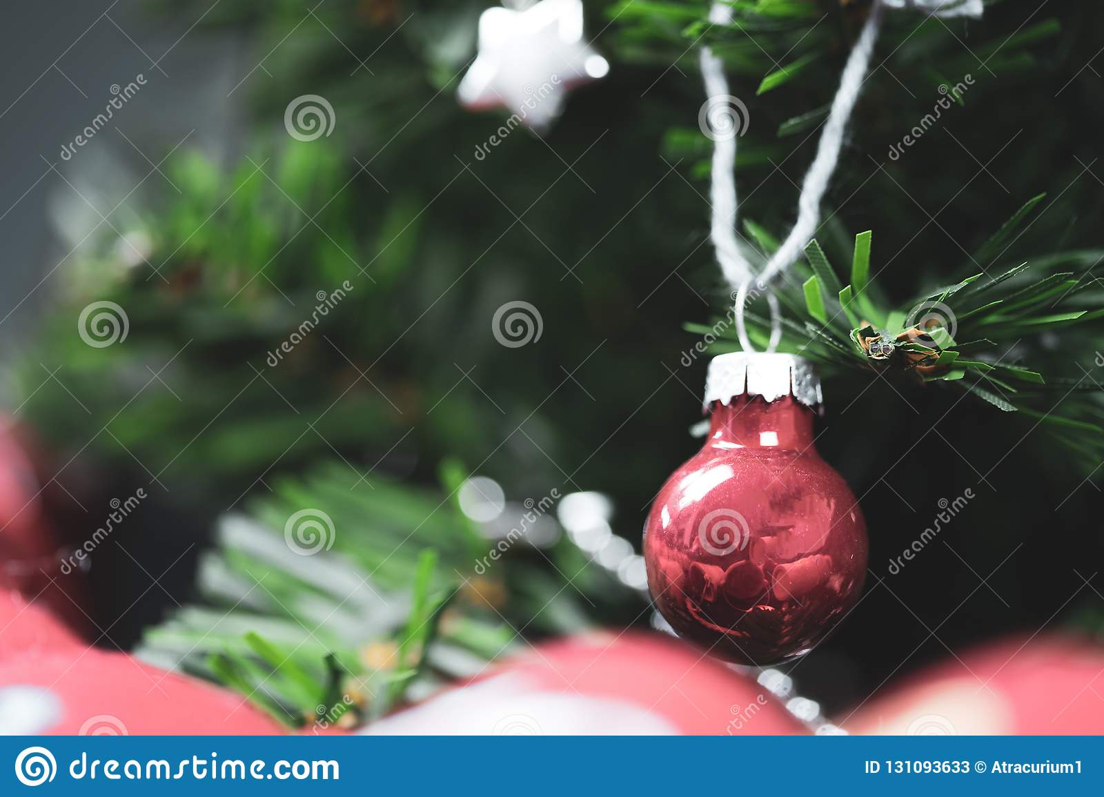 Red Glass Christmas Bauble Hanging From A Tree Stock Image Image