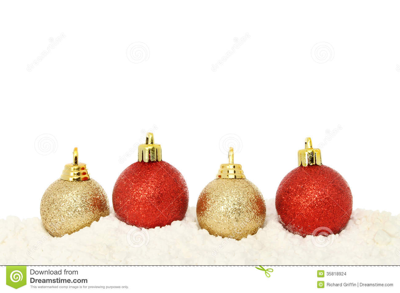 56476a0fc0a0 Red and gold Christmas baubles on snow with white copy space above