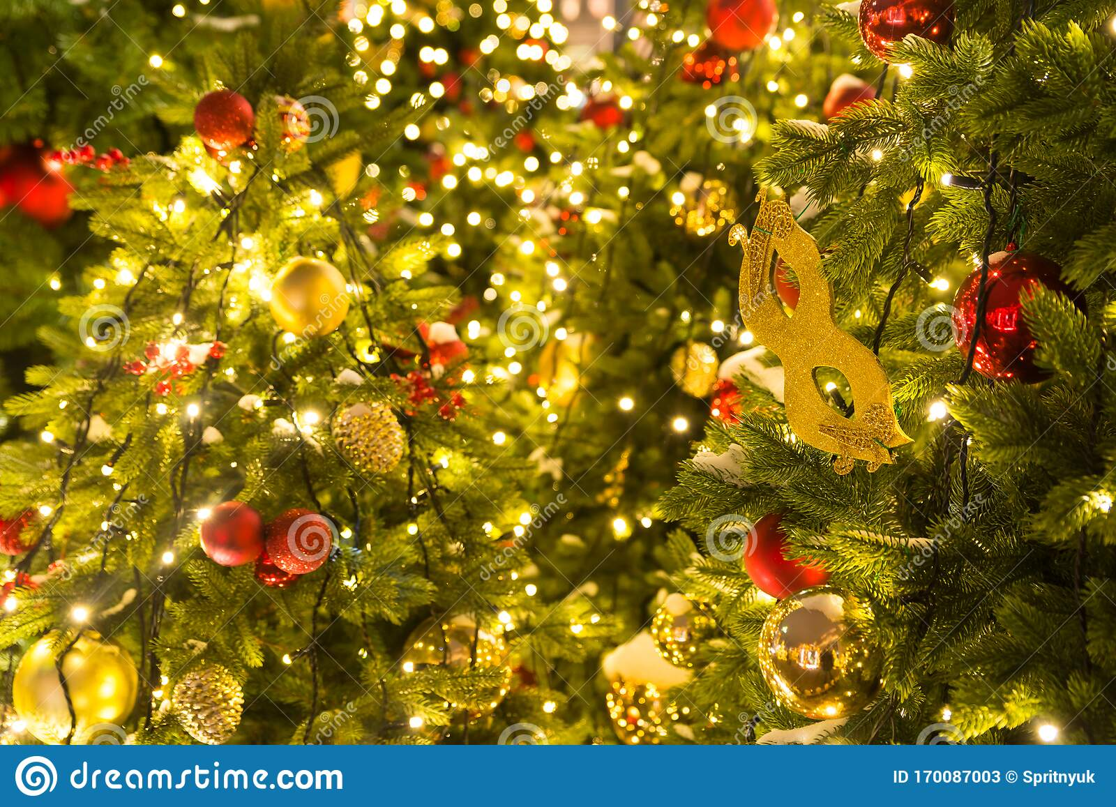 Red And Gold Christmas Decorations And Balls On The Christmas Tree With Yellow Garlands Stock Image Image Of Decorations White 170087003