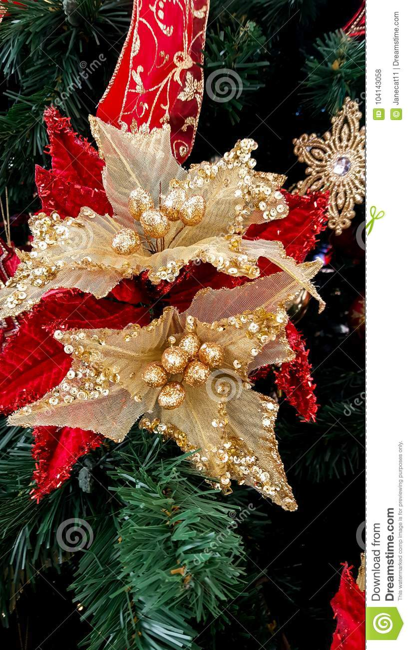 download christmas tree with fake flowers as ornamental decorations stock photo image of gold - Christmas Tree Flower Decorations