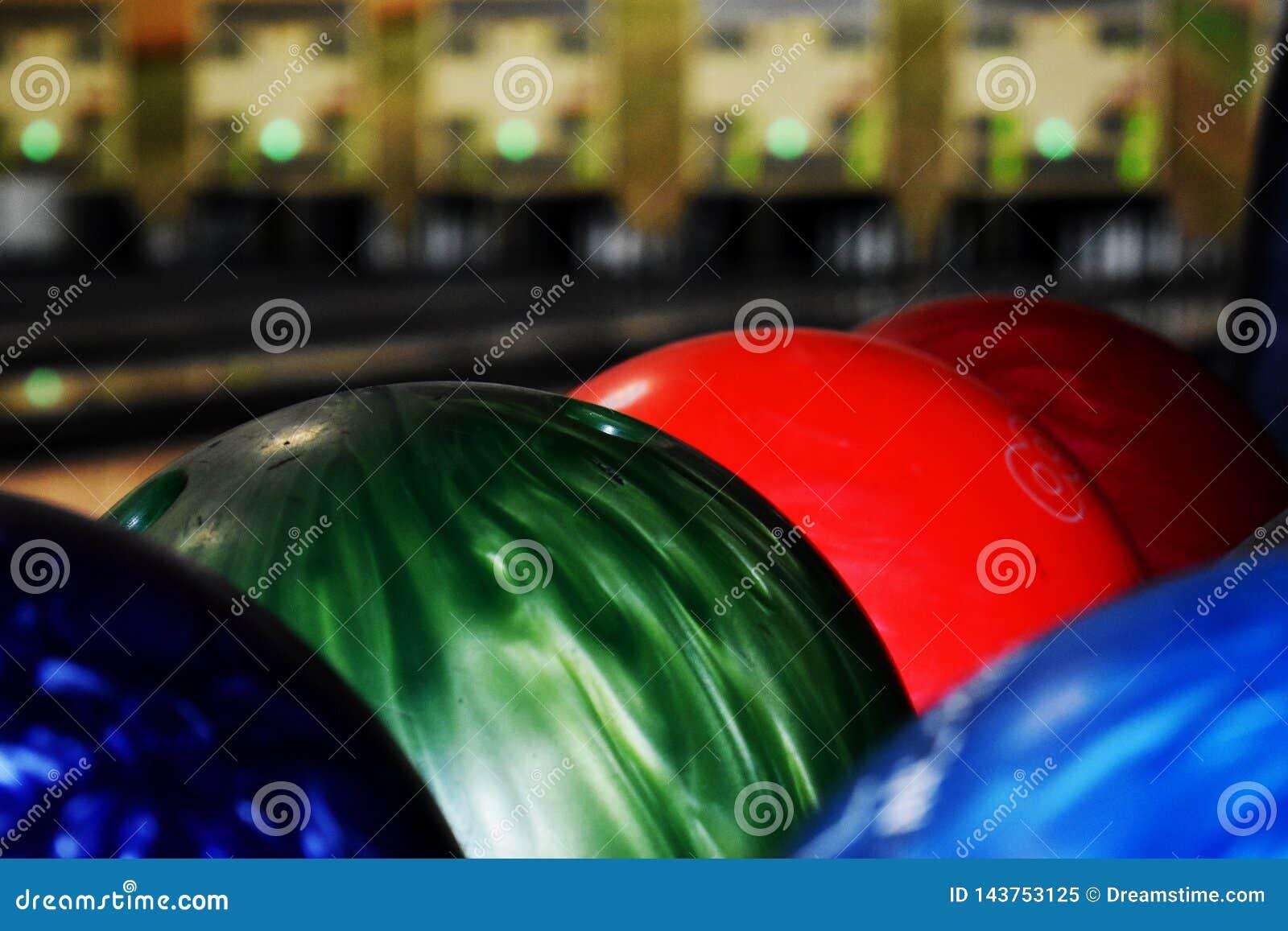 Red green blue bowling balls