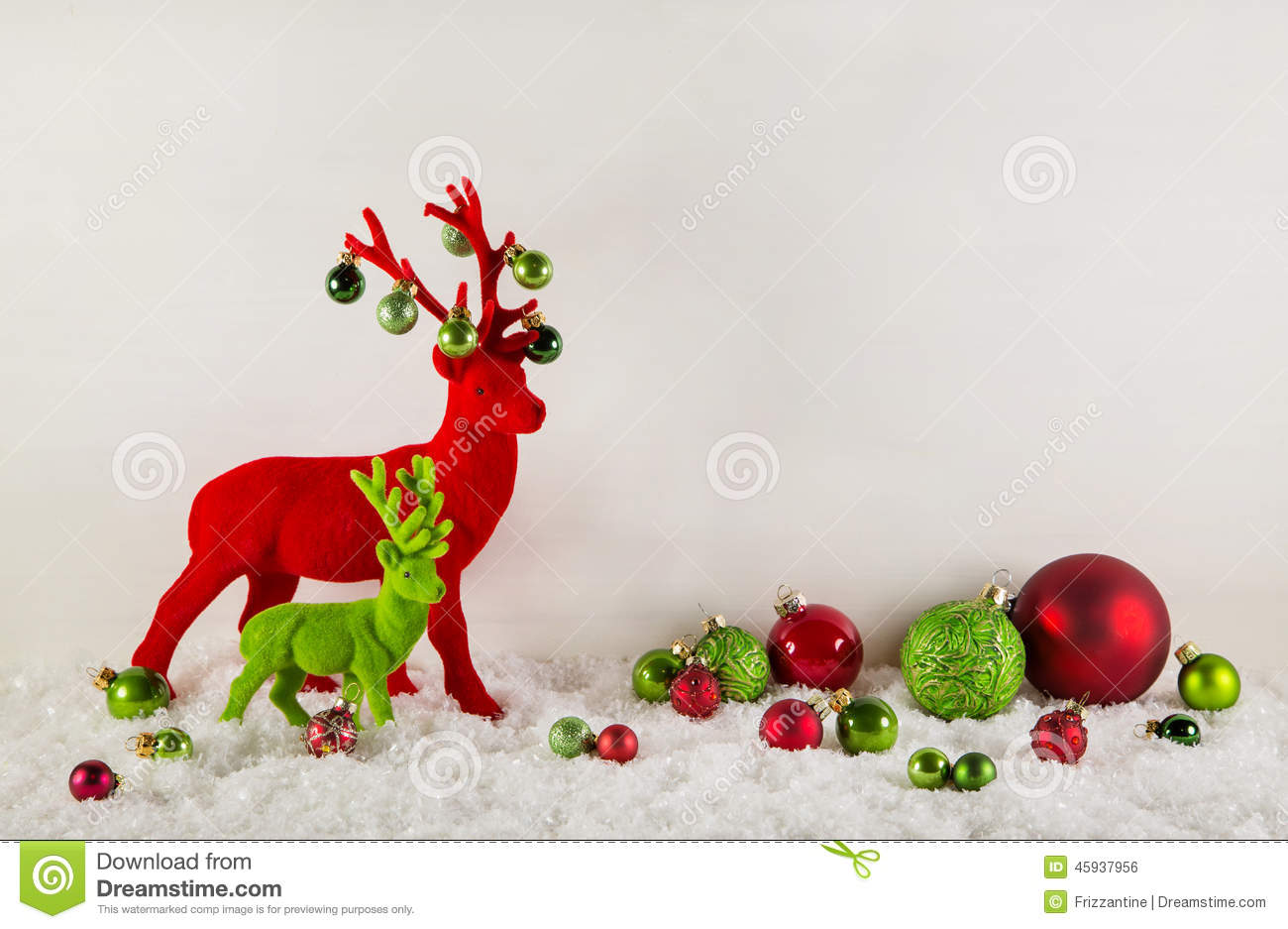 Red and green christmas decoration with reindeer and snow for Red white green christmas decor